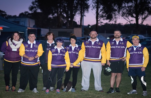 Staff wearing relay for life jumpers