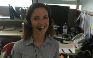 Lady smiling at camer wearing headset