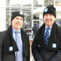 Two men smiling at camera wearing beanies