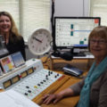 Elisabeth in a radio station speaking to Liz