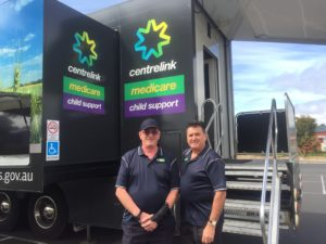 Ian and Andrew standing out the front of a Mobile Service Centre