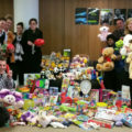 Staff posing with collection of toys