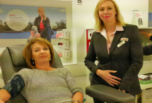 Denise getting ready to donate blood at the Blood Donor Centre with Sally standing beside her