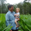 Heyden Lane with his daughter in a paddock of turmeric.