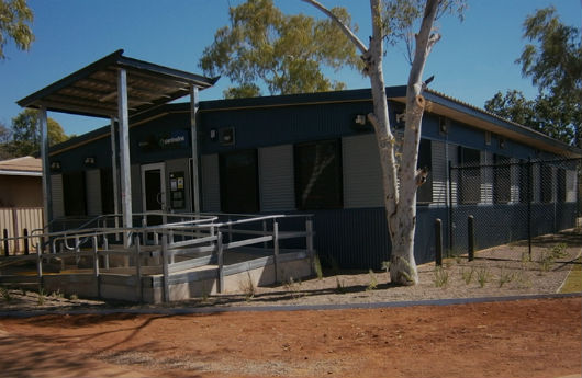The outside view of a large modular building in Halls Creek