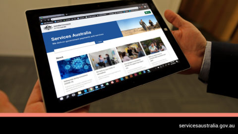 A tablet displaying the Services Australia website